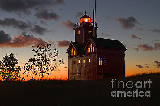 Big Red Lighthouse Aglow by OiLin Jaeger