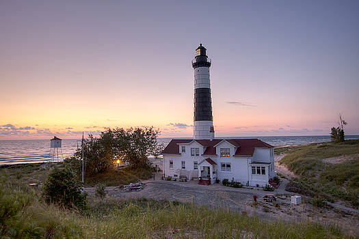 Big Sable Point Lighthouse at Sunset by Adam Romanowicz