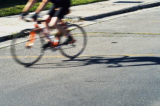 Biking Motion by Kae Cheatham