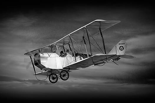 Randall Nyhof - Biplane with Cloudy Sky in Black and White