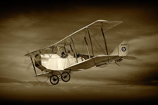 Randall Nyhof - Biplane with Cloudy Sky in Sepia Tone