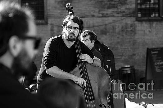 Black And White Contrabass Player by Luca Lorenzelli