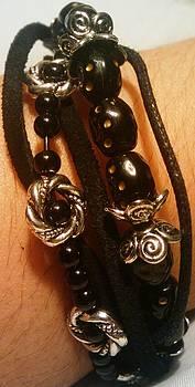Black bead and suede bracelet by Tashamee Dorsey