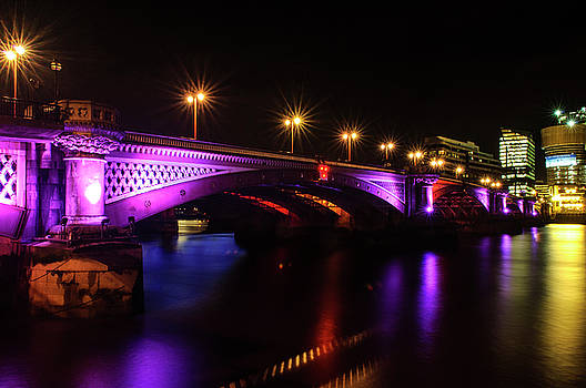 Blackfriars Bridge Illuminated in Purple by Paul Warburton