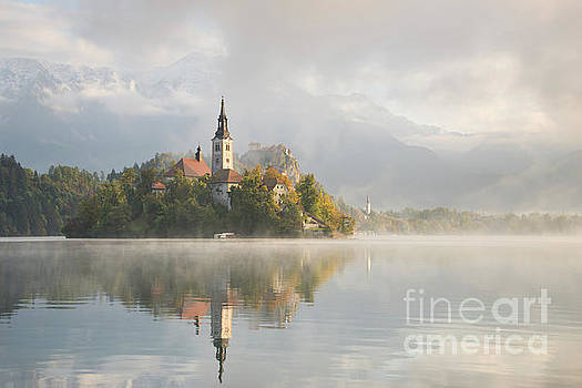 Bled Lake on a beautiful foggy morning by IPics Photography