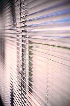 Eduardo Huelin - Blinds in a home catching the sunlight
