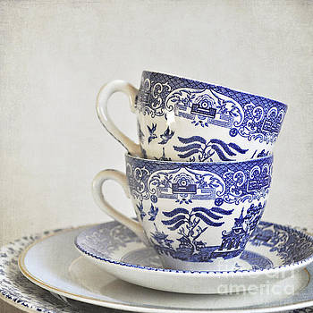 Blue and white stacked china. by Lyn Randle