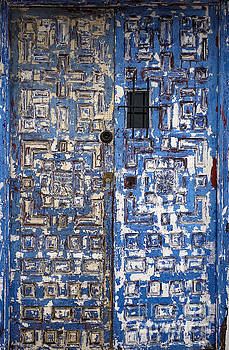 Blue andalusian door by Perry Van Munster