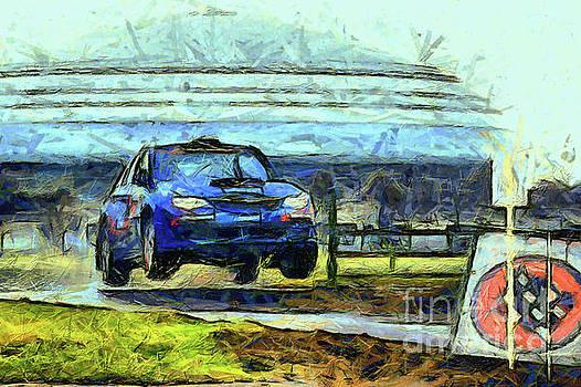 Blue car jumping by Magomed Magomedagaev