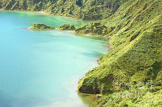 Blue crater lake ocean island by Jan Brons