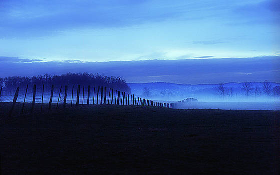 Blue fog and fence by Earl Carter