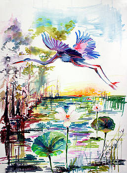 Ginette Callaway - Blue Heron Glides over Lotus Flowers