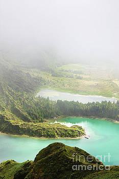 Blue lake in clouds by Jan Brons