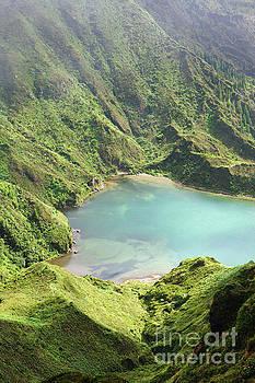Blue lake mountain slope by Jan Brons