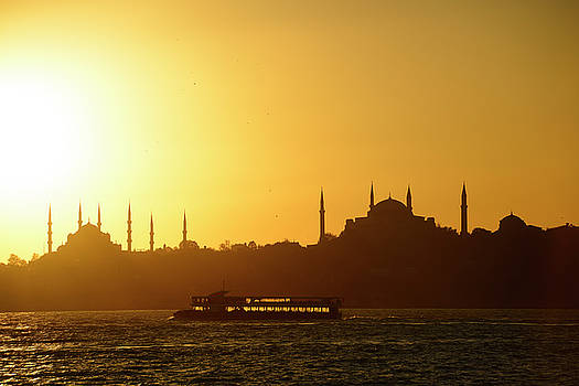 Reimar Gaertner - Blue Mosque and Hagia Sophia minarets silhouettes at sundown ove