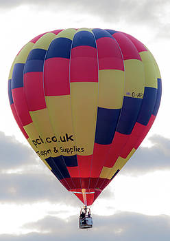 Blue, Red and Yellow Hot Air Balloon by Scott Lyons