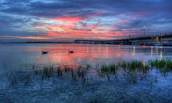 Blue sunset by John Loreaux