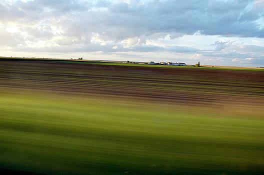 Sami Sarkis - Blurred landscape seen from a speeding car