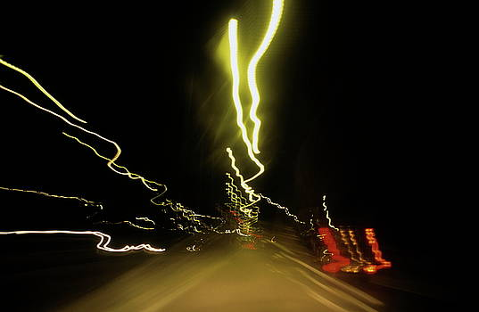 Sami Sarkis - Blurred tail lights of highway traffic at night