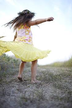 Blurred View Of Little Girl Twirling by Gillham Studios