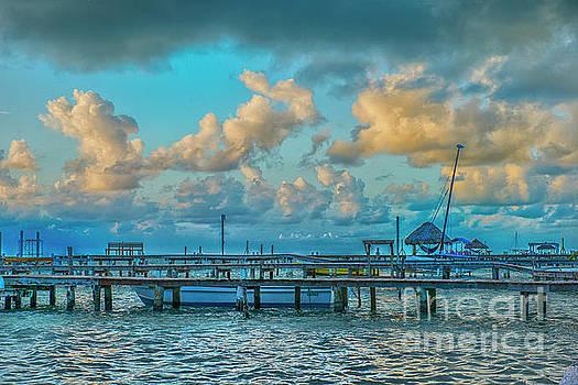 Boat Docks and Sunrise Clouds by David Zanzinger