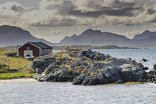 Boat house on the rocky shore of the North Atlantic on Lofoten by Intensivelight