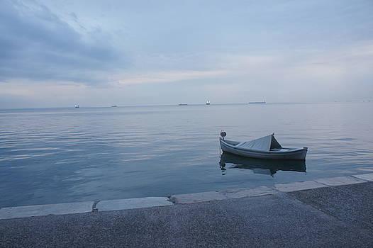 Boat in the sea by Emmanuel Varnas