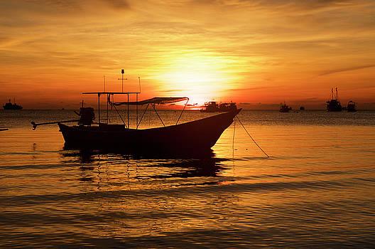 Boat on sunrise background by Tamara Sushko