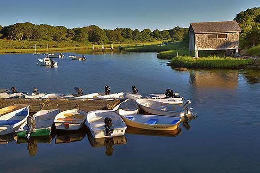 Boathouse on lake by Jack Nevitt