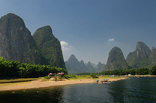 Reimar Gaertner - Boats and rest stop on the Li river China with tall karst format