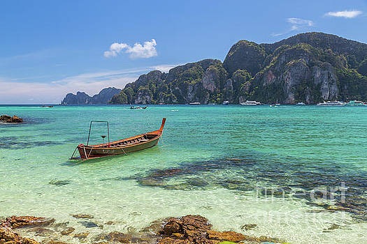 Boats, the Andaman Sea and hills in Ko Phi Phi Don, Thailand by Travel and Destinations - By Mike Clegg