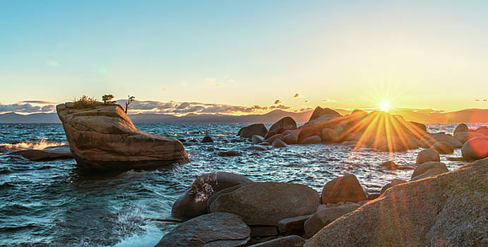 Bonsai Rock Lake Tahoe Summer Sunset with Waves Crashing and Hazy Light Blue Sky and Strong Sun Rays by Brian Ball