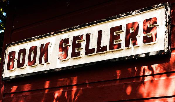 Book sellers in red by Terepka Dariusz