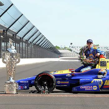 Borgwarner Trophy with Indy 500 winner by Rob Banayote