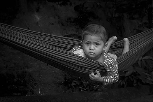 Boy in hammock by Hitendra SINKAR