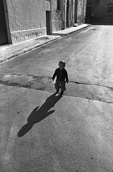 Boy in Street in Brindisi Italy by Alan Mogensen