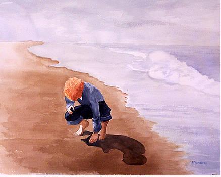 Boy on the beach by Robert Thomaston