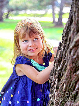 Braelyn playing by tree by James Steele
