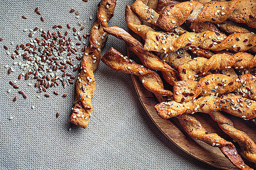 Bread Sticks with seeds close up by Valentin Valkov