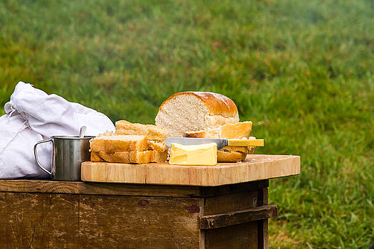 Jacek Wojnarowski - Bread with butter on cutting board