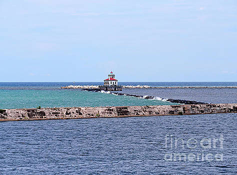 Breakwater and lighthouse in Oswego New York by Louise Heusinkveld
