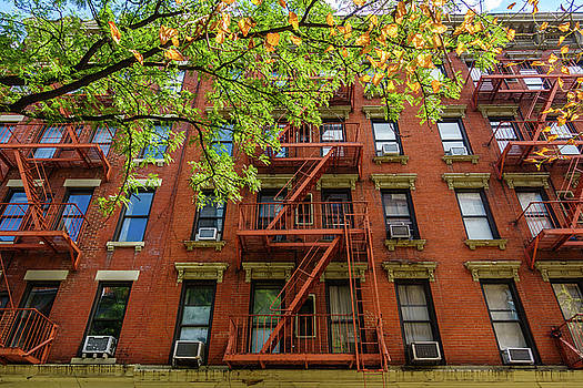 Brick building facade in New York City by Dutourdumonde Photography
