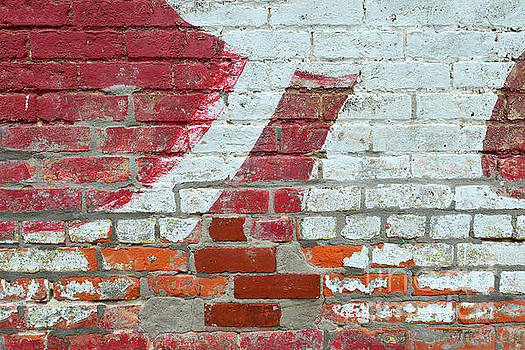 Brick Wall Advertisement Detail by Catherine Sherman