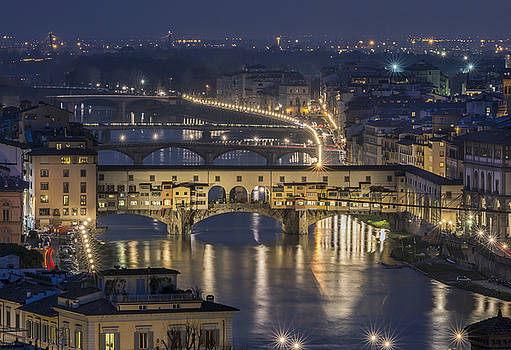 Bridges of Florence at night in Italy by Ayhan Altun