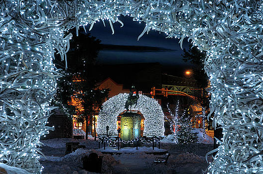 Reimar Gaertner - Brightly lit Elk antler arches in Jackson Wyoming town square in