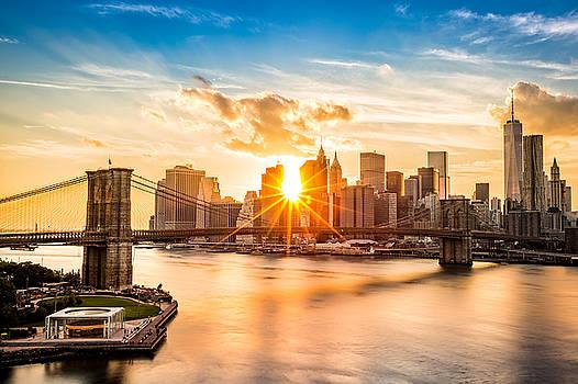 Brooklyn Bridge and the Lower Manhattan skyline at sunset by Mihai Andritoiu