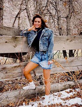 Steve Krull - Brunette Cowgirl by Split Rail Fence