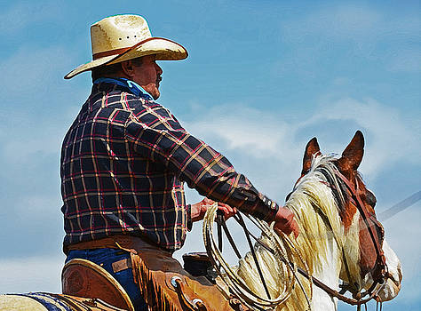 Buckaroo riding into blue by Susie Fisher
