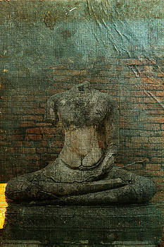 Buddha statue broken on book by Phiseksit Inthip