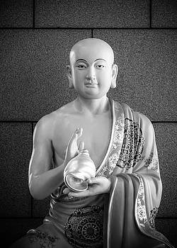 Buddhist Monk with Conch Shell Statue by Alexander Kunz